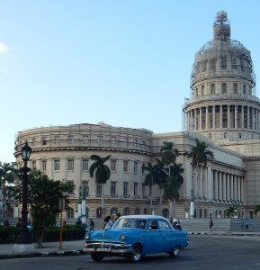 A typical Cuban car navigates the traffic circle around the Capital (under construction in Feb. 2016)