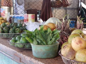 A street-side market stall offers in-season fresh fruit and vegetables