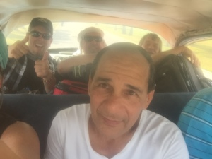 A crowded taxi ride makes for a true Cuban experience